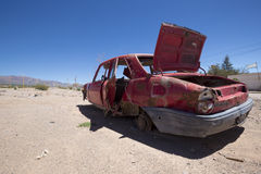 Abandonned red old Peugeot car on ruta 40, Argentina Stock Photo