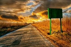 Abandonned road with a sign Royalty Free Stock Image