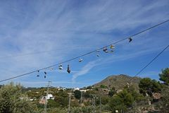 Abandonned shoes at Rio Chillar walk in Nerja in Andalusia, Spain. Warn off shoes on road  to Rio Chillar walk in the mountains of Nerja in Southern Spain stock photos