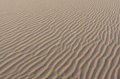 Abandonnez les ondulations de sable Image stock