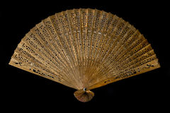 Abanico de madera. Old wooden shed fan on a black background Stock Photos