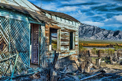 Old abandoned house with train tracks and mountains Stock Images