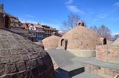 Abanotubani - distrito caliente de los baños del azufre en Tbilisi vieja Imagen de archivo libre de regalías
