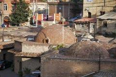 Abanotubani es el distrito antiguo de Tbilisi, Georgia, conocida para sus baños sulfúricos Abanotubani está situado en el banco d Fotografía de archivo libre de regalías