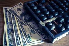 Abaque avec des billets d'un dollar Photo stock