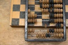 Abaque et échecs Photos stock