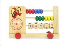 Abaque et horloge de jouet sur des roues Photographie stock libre de droits