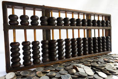 Abaque et pièce de monnaie Photos stock