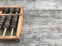 Abaque sur le fond en bois avec l'espace Photo stock