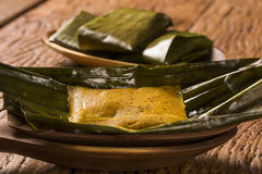 Abara, African food on banana leaf.  Royalty Free Stock Photos