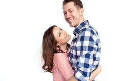 Abarcamiento alegre del hombre y de la mujer Fotos de archivo