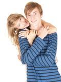 Abarcamiento cariñoso joven feliz de los pares Foto de archivo libre de regalías