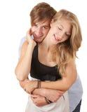 Abarcamiento cariñoso joven feliz de los pares Imagen de archivo libre de regalías