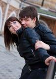 Abarcamiento feliz de la gente joven Fotografía de archivo libre de regalías