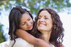 Abarcamiento feliz de la madre y de la hija Foto de archivo libre de regalías