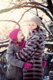 Abarcamiento feliz de la madre y de la hija Imagen de archivo