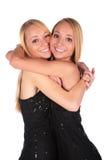 Abarcamiento gemelo de las muchachas Imagen de archivo libre de regalías