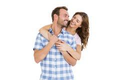 Abarcamiento joven feliz de los pares Foto de archivo libre de regalías