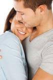 Primer de los pares jovenes abrazados Imagen de archivo libre de regalías