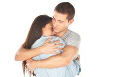 Primer de los pares jovenes abrazados Imágenes de archivo libres de regalías