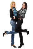 Abarcamiento sonriente de dos muchachas Foto de archivo libre de regalías