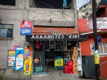 Abarrotes Kiki in Naucalpan, Mexico. NAUCALPAN, MEXICO-July 16, 2017. A neighborhood store front in Naucalpan that sells general food and merchandise royalty free stock photos