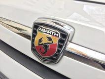 Abarth logo på den vita bilen Fotografering för Bildbyråer