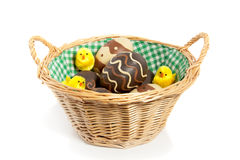 Abasket with easter eggs and chicks Royalty Free Stock Images