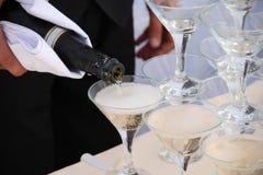 Abastecimiento - pirámide de los vidrios del champán Imagen de archivo libre de regalías