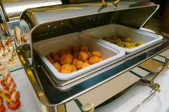 Abastecimiento - tabla servida con las pepitas y otra Fotografía de archivo