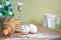 Abastract christmas food backing background concept with silver tree and ingredients royalty free stock photo