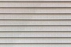 Abat-jour fermés faits en tissu beige Photographie stock