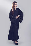 Abaya. Super model modeling for traditional Abaya dresses Stock Image