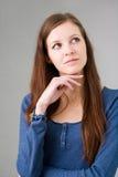 Abbastanza giovane riflettere della ragazza dell'allievo. Fotografie Stock Libere da Diritti