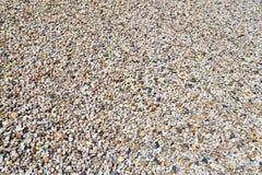 Abbauen des Kieses und des Sandes in einer Kiesgrube - Hintergrundkiesel Stockbild