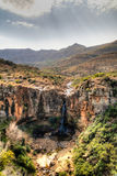 Abbellisca con il campo dell'agricoltura, il canyon del fiume di Makhaleng e la cascata intorno a Malealea, Lesotho Fotografia Stock Libera da Diritti