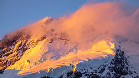 Abbellisca il dettaglio del ghiacciaio nel tramonto dorato variopinto, NZ Fotografie Stock