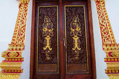 Thailand Pagoda doors. Carved entrance gate of the pagoda Stock Image