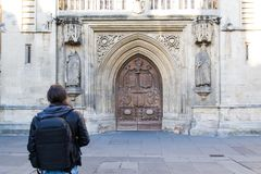 Bath Abbey - Professional photographer in front of a sculpture detail. Royalty Free Stock Photos