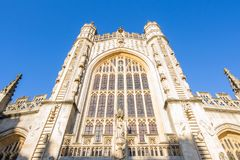 Bath Abbey with soft light and blue sky. Stock Photos