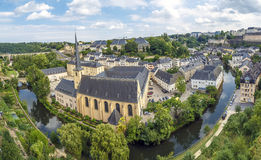 Abbey de Neumunster in Luxembourg City. Summer panorama of Abbey de Neumunster in Luxembourg City Stock Images