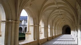 Abbey of Fontevraud. The cloister galleries. Abbey of Fontevraud. One of the most famous medieval monasteries of France. The cloister galleries Royalty Free Stock Image