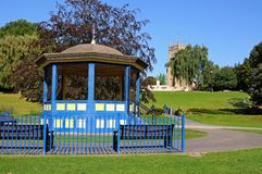 Abbey Gardens bandstand, Evesham. Bandstand in Abbey Gardens with the Abbey clock tower to the rear, Evesham, Worcestershire, England, UK, Western Europe Royalty Free Stock Images