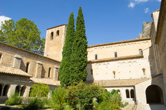 Abbey of Gellone in historic Southern French village  St Guilhem Stock Images