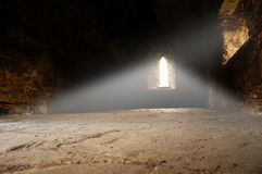 Abbey interior ray of light B. Interior of a medieval abbey with ray of light shining in Royalty Free Stock Image