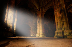 Abbey interior ray of light C. Interior of a medieval abbey with ray of light shining in Stock Photo