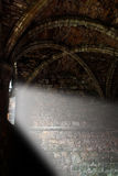 Abbey interior ray of light. Interior of a medieval abbey with ray of light shining in Stock Photo