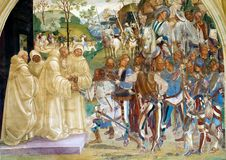 Abbey of Monte Oliveto Maggiore. How St Benedict recognizes and welcome Totila fresco, date 1439. The frescoes of life of St Benedict was painted by Luca royalty free stock image
