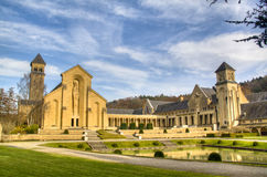 The abbey of Orval in Belgium. The abbey in Orval, Belgium is famous for its trappist beer, botanical garden and ruins of the former monastery Royalty Free Stock Photography