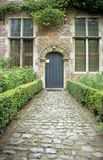 Abbey Path. A cobblestone path leads to the doorway of an Abbey in Leuven, Belgium royalty free stock photo